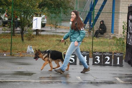 KIEV,UKRAINE-OCTOBER 15:An unidentified girl shows her dog at the Kiev Regional exhibition of dogs , on October 15, 2011 in Kiev,Ukraine