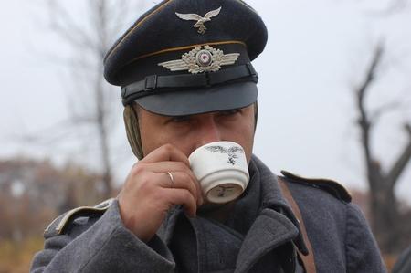 re enacting: KIEV, UKRAINE -NOV 6: Unidentified member of Red Star history club wears historical German Luftwaffe uniform during historical reenactment of WWII, November 6, 2011 in Kiev, Ukraine