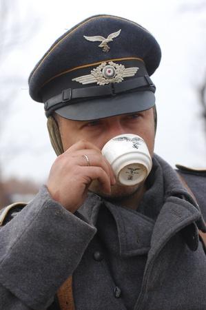 re enaction: KIEV, UKRAINE -NOV 6: Unidentified member of Red Star history club wears historical German Luftwaffe uniform during historical reenactment of WWII, November 6, 2011 in Kiev, Ukraine