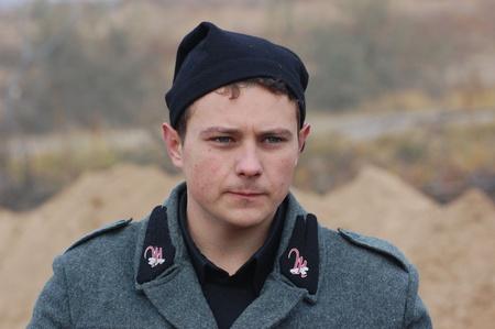 reenacting: KIEV, UKRAINE -NOV 6: Unidentified member of Red Star history club wears historical Italian uniform during historical reenactment of WWII, November 6, 2011 in Kiev, Ukraine  Editorial