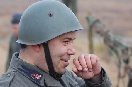 re enacting: KIEV, UKRAINE -NOV 6: Unidentified member of Red Star history club wears historical Italian uniform during historical reenactment of WWII, November 6, 2011 in Kiev, Ukraine  Editorial