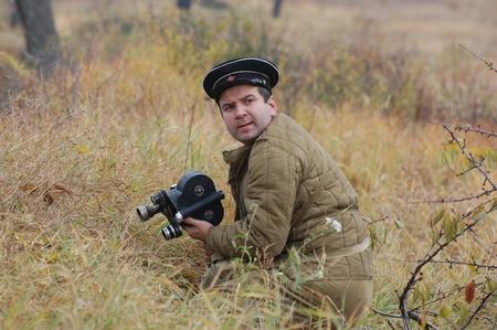 re enacting: KIEV, UKRAINE -NOV 6: Unidentified member of Red Star history club wears historical Soviet uniform during historical reenactment of WWII, November 6, 2011 in Kiev, Ukraine  Editorial