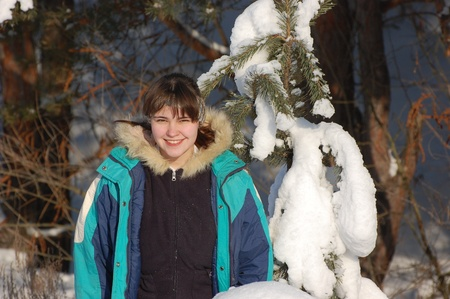 Teenager girl play in winter time. Near Kiev,Ukraine  photo