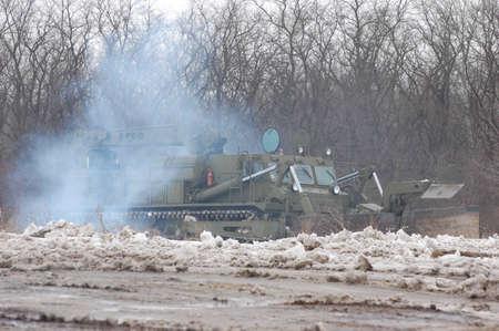 KIEV, UKRAINE -FEB 24:Heavy-duty Soviet military tractor in action during historical reenactment of WWII, February 24, 20112 in Kiev, Ukraine
