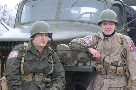re enacting: KIEV, UKRAINE -FEB 25:Unidentified members of Red Star history club wear historical American uniforms during historical reenactment of WWII, on February 25, 2012 in Kiev, Ukraine