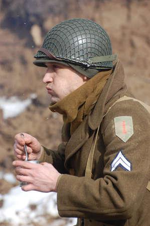 re enacting: KIEV, UKRAINE -FEB 25: Unidentified member of Red Star history club wears historical American uniforms during historical reenactment of WWII,Military history club Red Star on February 25, 2012 in Kiev, Ukraine