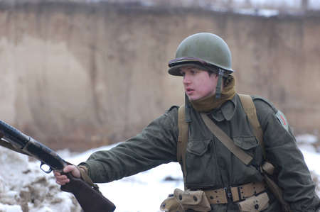 re enacting: KIEV, UKRAINE -FEB 25: Unidentified member of Red Star history club wears historical American uniforms during historical reenactment of WWII,Military history club Red Star on February 25, 2012 in Kiev, Ukraine