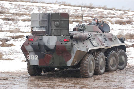 re enacting: KIEV, UKRAINE -FEB 25:Soviet armored truck created after WWII during historical reenactment of WWII,Military history club Red Star. February 25, 2012 in Kiev, Ukraine