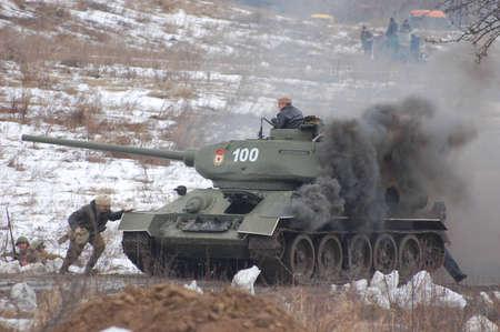 KIEV, UKRAINE -FEB 25: Old Russian tank T-34 during historical reenactment of WWII,Military history club Red Star. February 25, 2012 in Kiev, Ukraine
