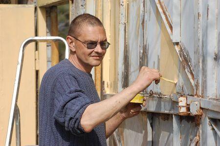 Man painting gate  Ukraine Stock Photo - 13087714