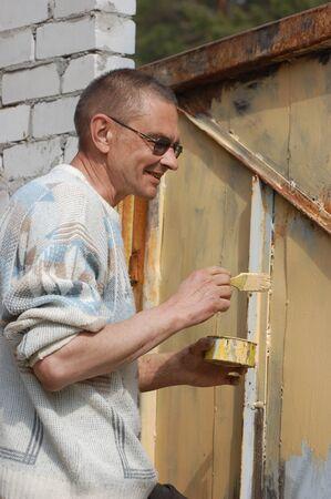 Man painting gate  Ukraine Stock Photo - 13087716
