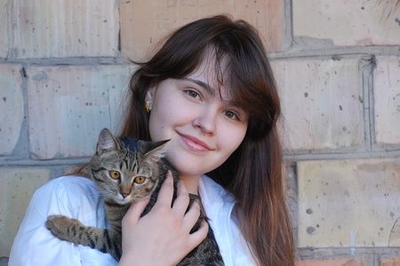 Girl with her cat  photo