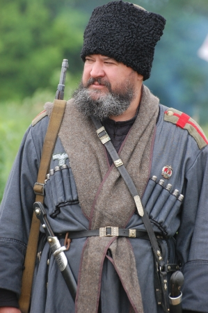 KIEV, UKRAINE -MAY 13: Member of Red Star history club wears historical uniform cossack of Corps von Panvits (German) during historical reenactment of WWII, May 13, 2012 in Kiev, Ukraine  Stock Photo - 13627100