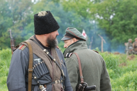 KIEV, UKRAINE -MAY 13: Member of Red Star history club wears historical uniform cossack of Corps von Panvits (German) during historical reenactment of WWII, May 13, 2012 in Kiev, Ukraine  Stock Photo - 13627073