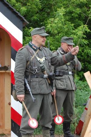 re enaction: KIEV, UKRAINE -MAY 13: Members of Red Star history club wear historical German uniform during historical reenactment of WWII, May 13, 2012 in Kiev, Ukraine