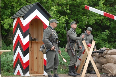 re enacting: KIEV, UKRAINE -MAY 13: Members of Red Star history club wear historical German uniform during historical reenactment of WWII, May 13, 2012 in Kiev, Ukraine