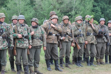 KIEV, UKRAINE -MAY 13: Members of Red Star history club wear historical German uniform during historical reenactment of WWII, May 13, 2012 in Kiev, Ukraine  Stock Photo - 13627102