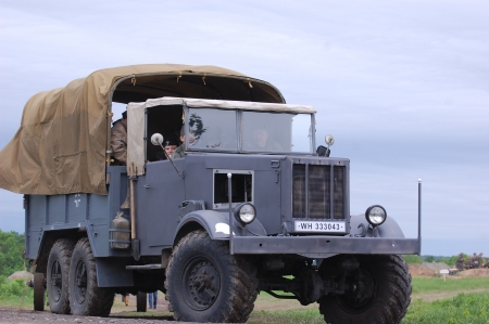 re enaction: KIEV, UKRAINE -MAY 13: Red Star military history club. German truck of WWII time during historical reenactment of WWII , May 13, 2012 in Kiev, Ukraine  Editorial