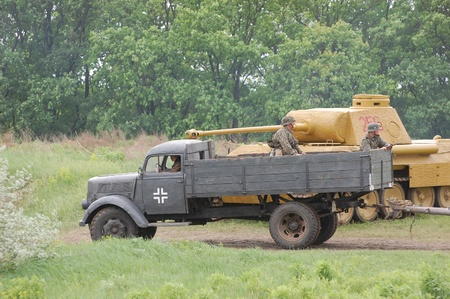 re enacting: KIEV, UKRAINE -MAY 13: Red Star military history club. German truck of WWII time during historical reenactment of WWII , May 13, 2012 in Kiev, Ukraine  Editorial