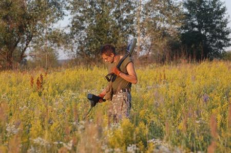 Treasure hunting in Ukraine Man with metal detector photo