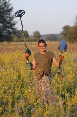 landmine: Treasure hunting in Ukraine Man with metal detector Stock Photo