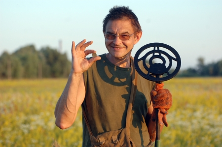 archeologist: Treasure hunting in Ukraine Man with metal detector Stock Photo