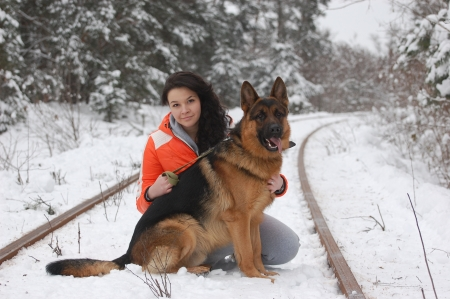 Teen girl with dog, winter forest in Ukraine photo