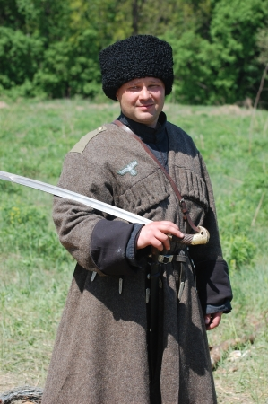 corps: KIEV, UKRAINE -MAY 11: Member of Red Star history club wears historical uniform cossack of Corps von Panvits (German) during historical reenactment of WWII, May 11, 2013 in Kiev, Ukraine