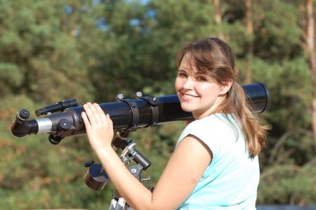 Teen girl and telescope    Near Kiev,Ukraine photo