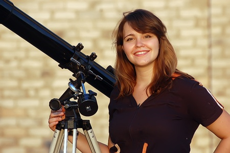 Teen girl and telescope, Near Kiev,Ukraine photo