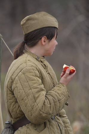 KIEV, UKRAINE -NOV 1  An unidentified member of Red Star history club wears historical Soviet uniform during historical reenactment of WWII, Battle for Kiev 1943 on November 1, 2013 in Kiev, Ukraine