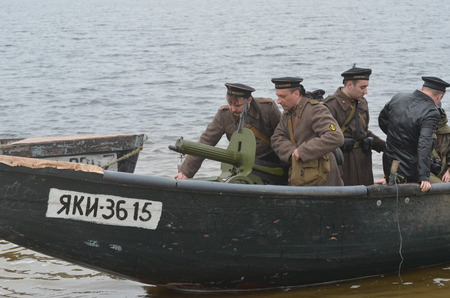 dnepr: KIEV, UKRAINE -NOV 3  An unidentified members of Red Star history club wear historical Soviet uniform during historical reenactment of WWII, Dnepr river crossing 1943, November 3, 2013   Kiev, Ukraine