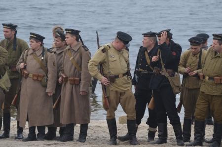 dnepr: KIEV, UKRAINE -NOV 3  An unidentified members of Red Star history club wear historical Soviet uniform during historical reenactment of WWII, Dnepr river crossing 1943, November 3, 2013   Kiev, Ukraine