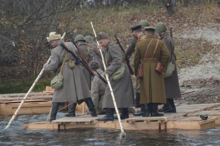 KIEV, UKRAINE -NOV 3  An unidentified members of Red Star history club wear historical Soviet uniform during historical reenactment of WWII, Dnepr river crossing 1943, November 3, 2013   Kiev, Ukraine