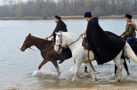 KIEV, UKRAINE -NOV 3  An unidentified members of Red Star history club wear historical Soviet uniform during historical reenactment of WWII, Dnepr river crossing 1943, November 3, 2013 Kiev, Ukraine