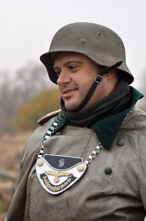 KIEV, UKRAINE -NOV 3  An unidentified member of Red Star history club wears historical German uniform during historical reenactment of WWII, Dnepr river crossing 1943, November 3, 2013  Kiev, Ukraine