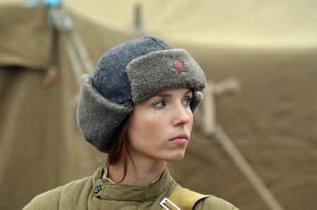 KIEV, UKRAINE -NOV 2 An unidentified member of Red Star history club wears historical Soviet uniform during historical reenactment of WWII, Battle for Kiev 1943 on November 2, 2013 in Kiev, Ukraine
