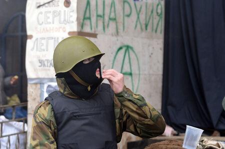 extremist: KIEV, UKRAINE - FEB 10, 2014  Downtown of Kiev Kids-soldiers of Ukrainian opposition   Riot in Kiev and Western Ukraine February 10, 2014 Kiev, Ukraine