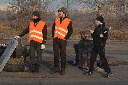 extremist: KIEV, UKRAINE - FEB 24, 2014  Traffic regulation point,created Peoples Selfdefense of Kiev Troeshina district Editorial