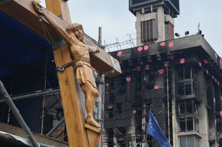 crucis: KIEV, UKRAINE - APR 7, 2014  Second crucifixion of Jesus Burned downtown of Kiev Rioters camp  Riot in Kiev and Western Ukraine April 7, 2014 Kiev, Ukraine