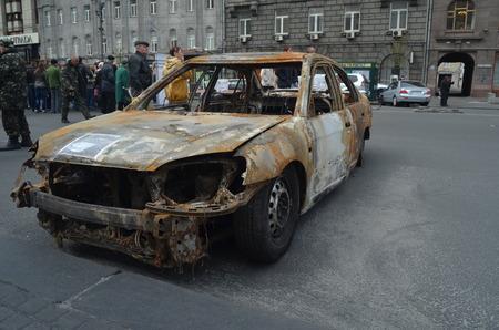 KIEV, UKRAINE - APR 7, 2014  Downtown of Kiev Situation in the city Burned car Riot in Kiev and Western Ukraine April 7, 2014 Kiev, Ukraine  Editorial