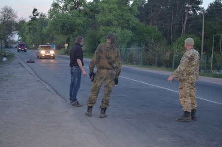 extremist: KIEV, UKRAINE - MAY 1, 2014  Checking the transport in the road to Kiev Checkpoint of paramilitary rioters   Riot in Kiev and Western Ukraine