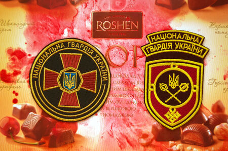 emblem of ukraine: Kiev,Ukraine.Dec 20.Illustrative editorial.Chevron of Ukrainian National Guard.With Roshen Inc. Trademark Roshen is property of ukrainian president Poroshenko.At December 20,2014 in Kiev,Ukraine