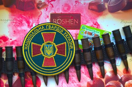 emblem of ukraine: Kiev,Ukraine.Dec 20.Illustrative editorial.Chevron of Ukrainian National Guard.With logo Roshen Inc. Trademark Roshen is property of ukrainian president Poroshenko.At December 20,2014 in Kiev,Ukraine