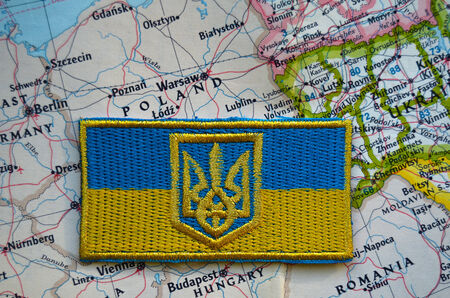 nazi flag: Kiev,Ukraine.JAN 10.Illustrative editorial. Chevron of Ukrainian nationalist formations.With map of Europe.  At January 10,2015 in Kiev, Ukraine