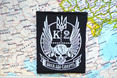 nationalist: Kiev,Ukraine.JAN 10.Illustrative editorial. Chevron of Ukrainian nationalist formations.With map of Europe.  At January 10,2015 in Kiev, Ukraine