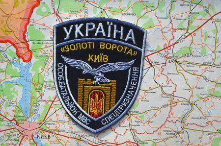 genocide: Kiev,Ukraine.JAN 10.Illustrative editorial. Chevron of Ukrainian nationalist formations.With map of Kiev Region.  At January 10,2015 in Kiev, Ukraine