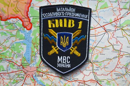 nazi flag: Kiev,Ukraine.JAN 10.Illustrative editorial. Chevron of Ukrainian nationalist formations.With map of Kiev Region.  At January 10,2015 in Kiev, Ukraine