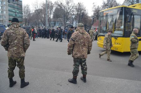 nationalists: KIEV, UKRAINE - February 2, 2015: Ukrainian nationalists of Battalion protest against president Poroshenko-- Protesters burned pyramid of tires near the gate of the Ministry of Defence