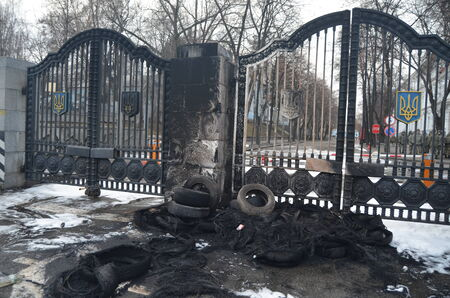 minister of war: KIEV, UKRAINE - February 2, 2015: Ukrainian nationalists of Battalion  protest against president Poroshenko-- Protesters burned pyramid of tires near the gate of the Ministry of Defence.